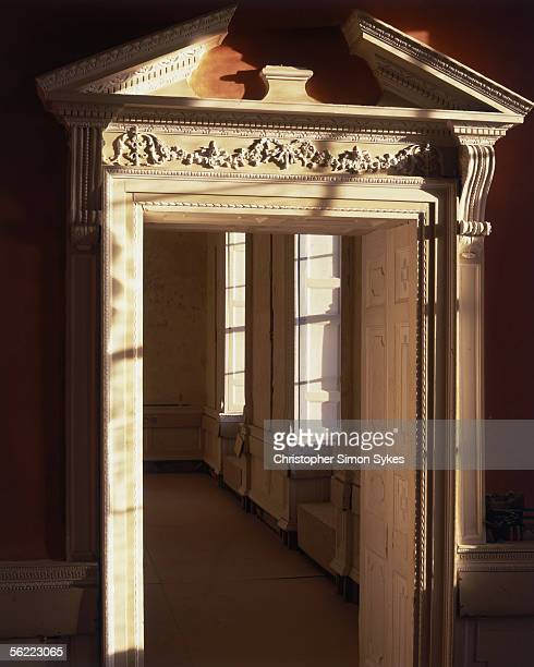 An intricately carved doorway in Castletown Cox County Kilkenny with a broken pediment 1990s