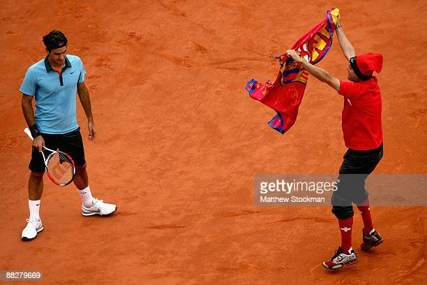 An intruder on the court interferes with Roger Federer of Switzerland during the Men's Singles Final match Robin Soderling of Sweden and Roger...