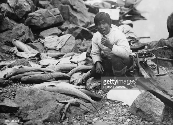 An Inuit fisherman with his catch