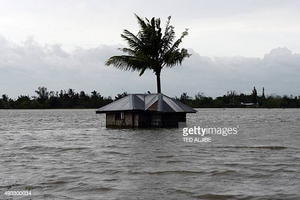 An inundated house is seen amid floodwaters in Santa Rosa town Nueva Ecija province north of Manila on October 19 a day after typhoon Koppu hit...