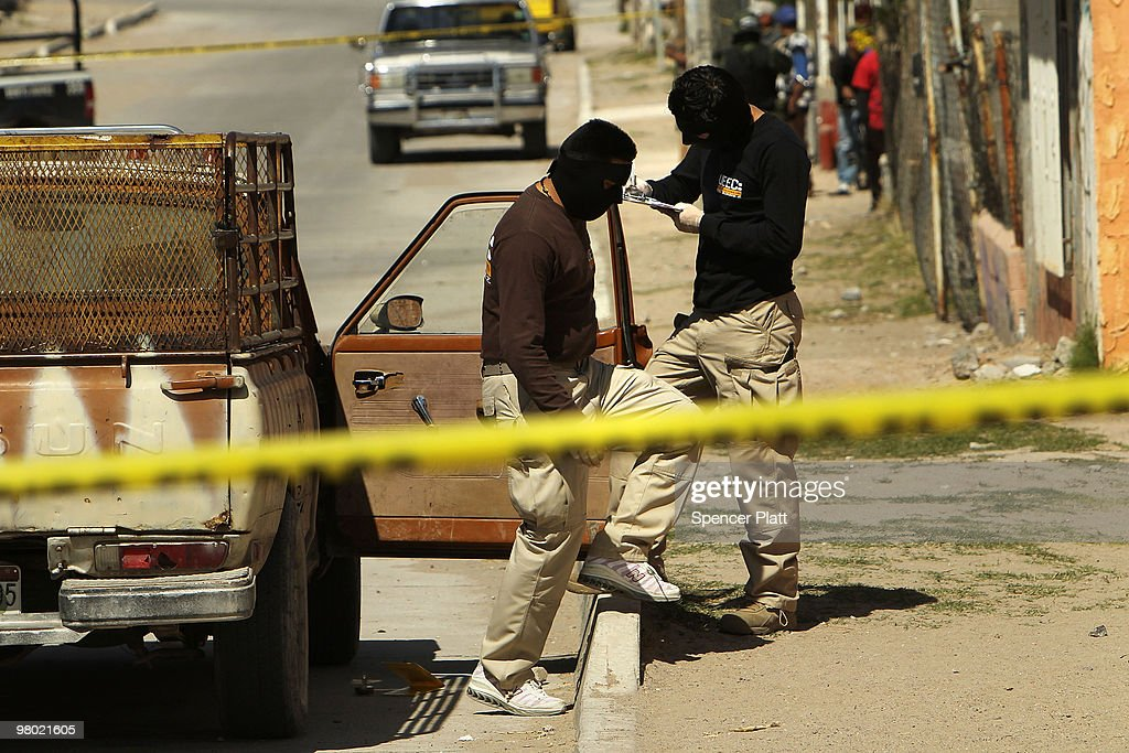 An investigative team analyzes the scene of the murder of two women aged 17 and 21 March 24 2010 in Juarez Mexico Secretary of State Hillary Rodham...
