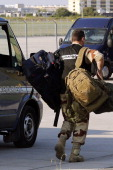 An investigator from the French Air Transport Gendarmerie carries his gear on July 25 2014 at VelizyVillacoublay's military airport west of Paris as...