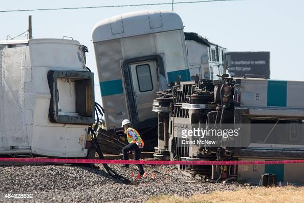 An investigator surveys the wreckage of a Los Angelesbound Metrolink train that derailed in a fiery collision with a truck on the tracks on February...