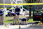 An investigator works a crime scene outside of the Curtis Culwell Center after a shooting occurred the day before May 04 2015 in Garland Texas During...