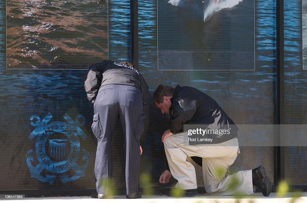 An investigators look at the scene of an earlier shooting at a US Coast Guard Recruiting station near the Potomac Mills Mall November 2 2010 in...