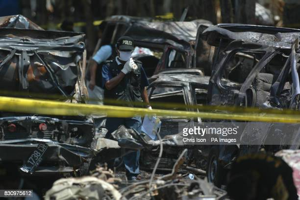 An investigators works amidst the rubble of the Sari Club in Kuta Bali as efforts continued to identify the victims of the car bomb attack at the...