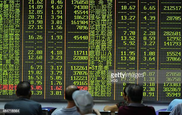 An investor observes the stock market at an exchange hall on August 21 2015 in Hangzhou Zhejiang Province of China Chinese shares rebounded on Friday...