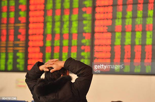 An investor observes the stock market at an exchange hall on January 13 2016 in Fuyang Anhui Province of China The Chinese stock market was volatile...