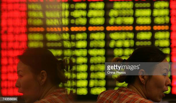 An investor reacts as she views the stock index at a securities company on May 30 2007 in Shanghai China The Shanghai Composite Index fell by 65%...