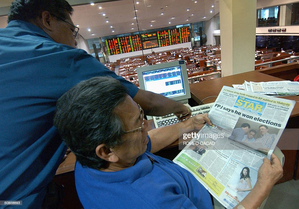 An investor reads a newspaper with a headline about movie star Fernando Poe claiming he won the presidential election at the Philippine Stock Exchange in Manila 20 May 2004. Philippine share prices closed marginally higher in light and cautious trade as investors picked up some oversold stocks while dealers doubt the sustainability of Thursday's gain due to concerns of high oil prices may spark inflation and uncompleted count of May 10 presidential election. The Philippine Stock Exchange composite index added 3.93 points or 0.27 percent to close at 1,472.25 ending a five-day losing streak.