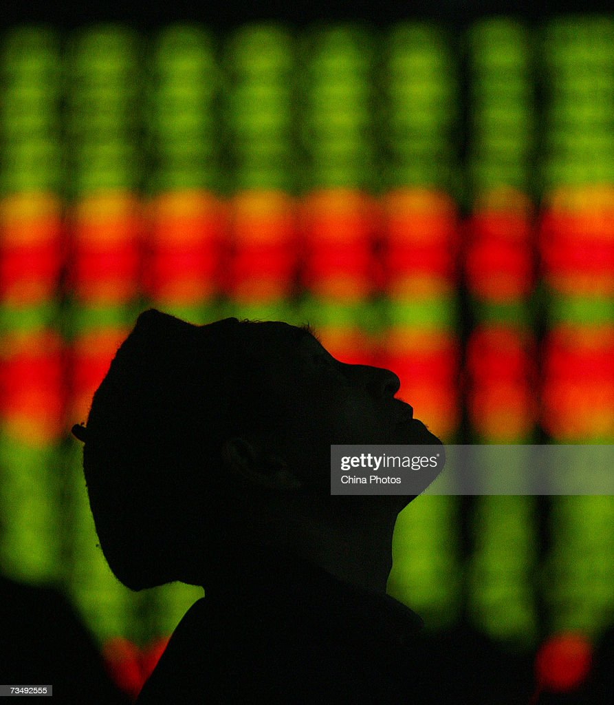An investor views the stock index through an electronic share price board at a securities company on March 5, 2007 in Chongqing Municipality, China. The Shanghai Composite Index fell 1.6 percent today as investors sold off holdings in foreign-currency denominated 'B-shares' after officials denied rumors those stocks might be merged with the mainstream Chinese-currency shares. The main Shanghai Composite Index closed at 2,783.31.