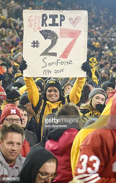 An Iowa fan holds up a sign saluting Nebraska punter Sam Foltz who was killed in a car crash earlier this year during a Big Ten Conference football...