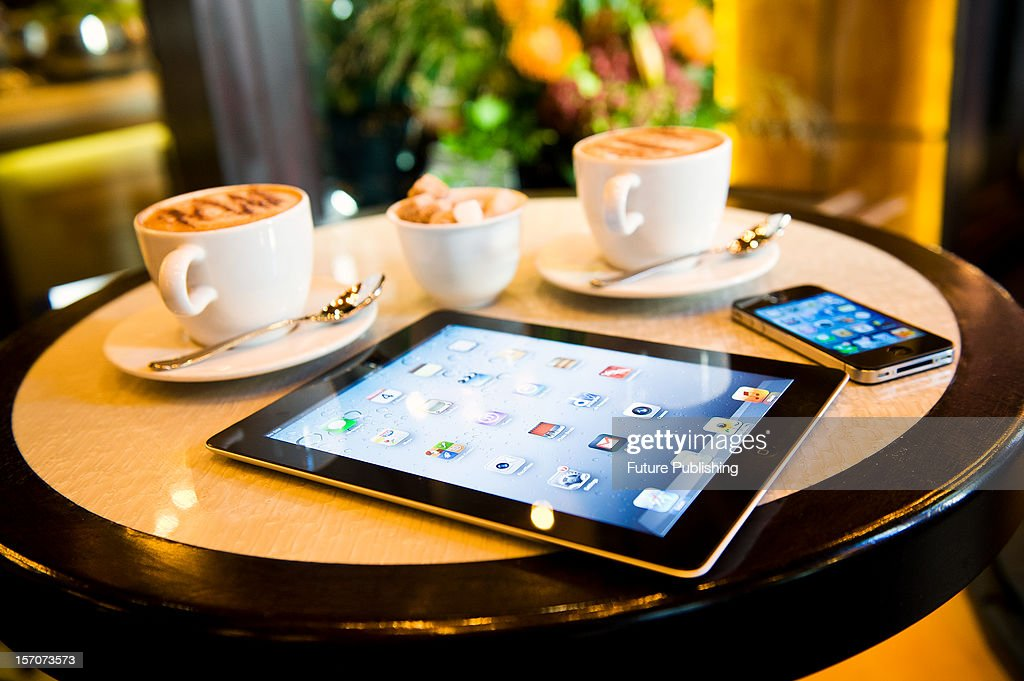 An iPad and iPhone in a cafe setting, October 4, 2012.