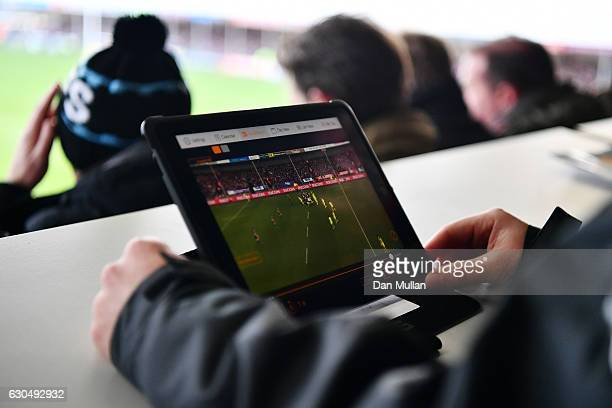 An iPad is monitored by a member of Exeter Chiefs staff for possible head injuries during the Aviva Premiership match between Exeter Chiefs and...