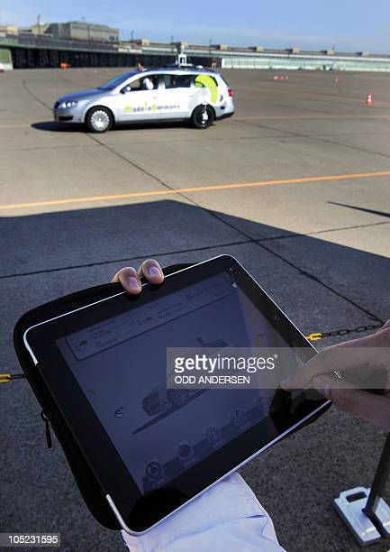 An ipad is used to call for a pick me up service for the driver less car 'Made in Germany' which from the outside looks like a regular Volkswagen...