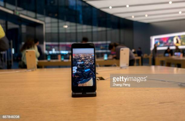 An iPhone 7 on the table in an Apple shop On the March 25 Apple opened the third retail shop in Nanjing city which is located in Nanjing Jinmao Plaza...