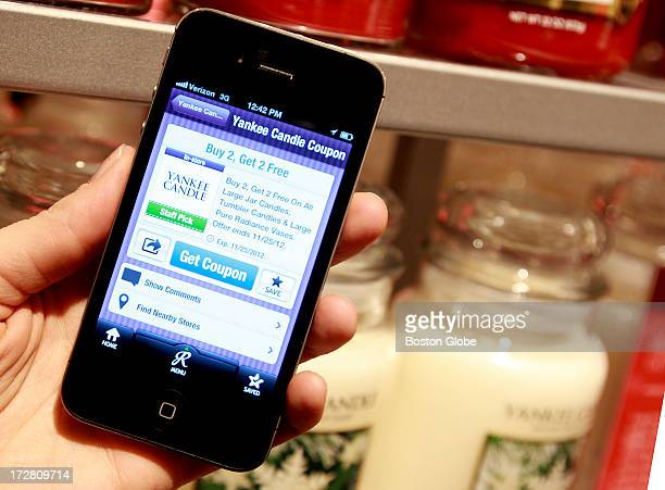 An iPhone app that allows you to find coupons online and redeem these at the stores such as at the Yankee Candle at the CambridgeSide Galleria Mall...