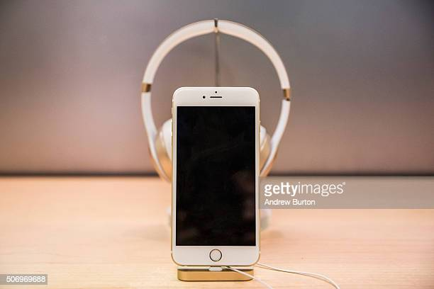 An iPhone sits on display inside the Apple store on Fifth Avenue on January 26 2016 in New York City This afternoon Apple reported the slowest iPhone...