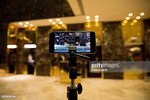 An iPhone streams a 'Facebook Live' live feed of the lobby at Trump Tower November 29 2016 in New York City Presidentelect Donald Trump and his...