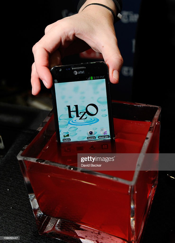 An iPhone using HzO Waterblock technology is displayed in a bowl of water during a press event at the Mandalay Bay Convention Center for the 2013 International CES on January 6, 2013 in Las Vegas, Nevada. CES, the world's largest annual consumer technology trade show, runs from January 8-11 and is expected to feature 3,100 exhibitors showing off their latest products and services to about 150,000 attendees.