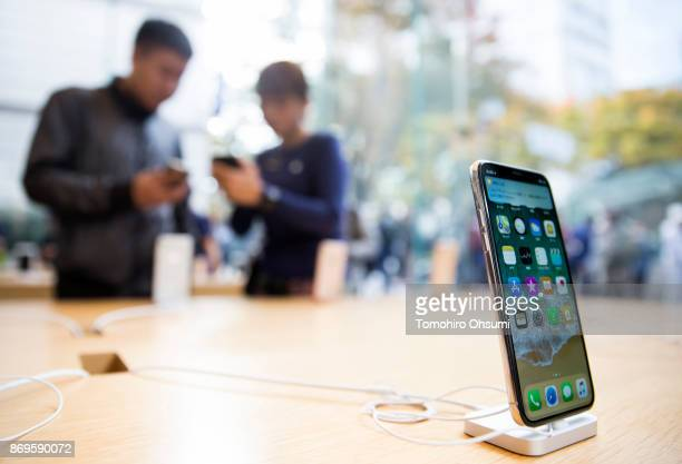 An iPhone X is seen at the Apple Omotesando store on November 3 2017 in Tokyo Japan Apple launched the latest iPhone featuring face recognition...