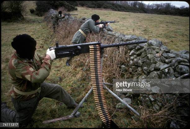 An IRA gunman with a Browning 50 calibre heavy machine gun during a training and propaganda exercise in Northern Ireland 12th February 1977