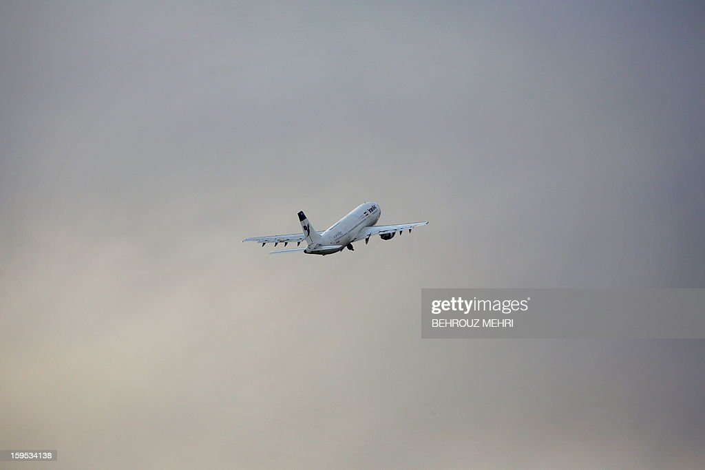 An Iran Air passenger plane takes off from the domestic Mehrabad airport in the Iranian capital Tehran on January 15, 2013. Austrian Airlines said the previous day that it has stopped its flights to Tehran because they were not profitable any more in a decision that comes after the subsidiary of German carrier Lufthansa had already in November cut the number of weekly flights from Vienna to the Iranian capital to three.