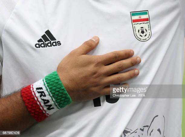 An Iran sweatban is seen on the wrist of Abolfazi Razzaghpour of Iran as he puts his hand to his heart during the FIFA U20 World Cup Korea Republic...
