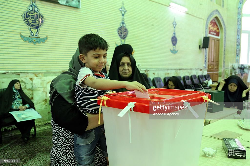 An Iranian boy casts a ballot during a second round of parliamentary elections at a polling station in Shahriar district of Tehran, Iran on April 29, 2016.