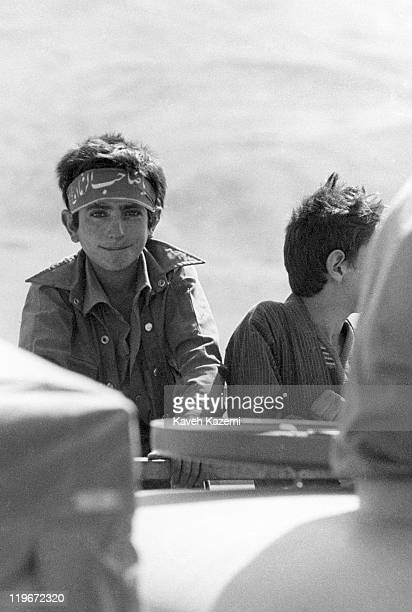 An Iranian boy dressed in war fatigues heads towards the front after an Iranian counteroffensive in Hajomran northern Iraq during the IranIraq War...