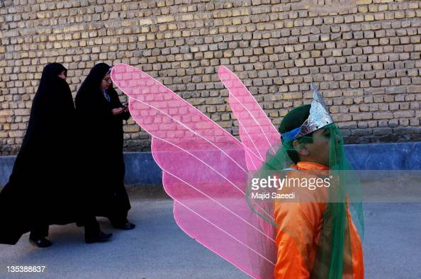 An Iranian boy dresses as an angels as he commemorates the battle of Ashura December 6 2011 in the Khomeini Shahr suburb of the central Iranian city...