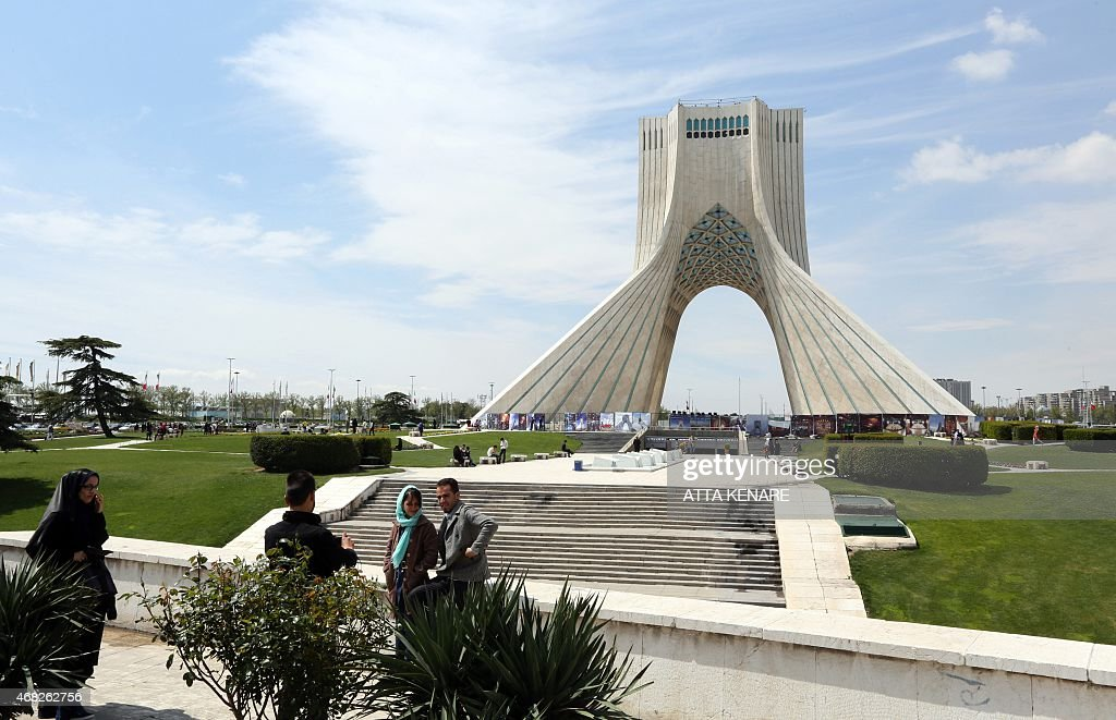 An Iranian couple have their picture taken in front of the Azadi Tower also known as Liberty Tower which is a landmark in the Iranian capital at the...