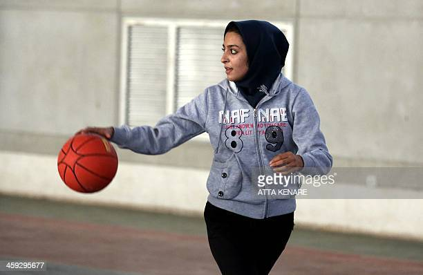 An Iranian female basketball players trains in the Fajr stadium in the city of Bam following an earthquake 10 years ago that destroyed the historical...