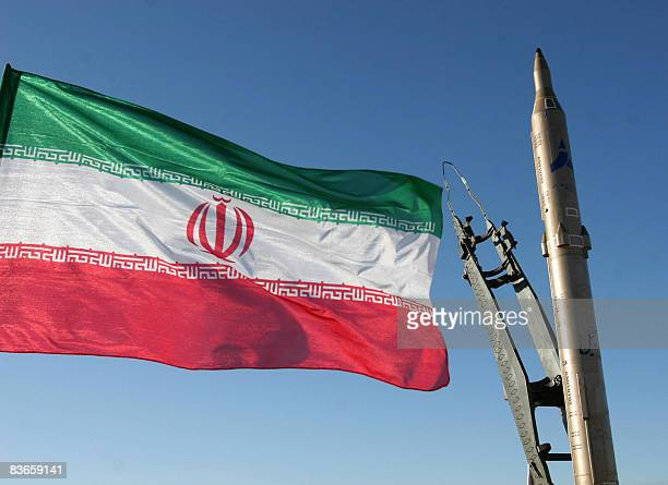 An Iranian flag flutters next to a groundtoground Sajil missile before being launched at an undisclosed location in Iran on November 12 2008 Iran...