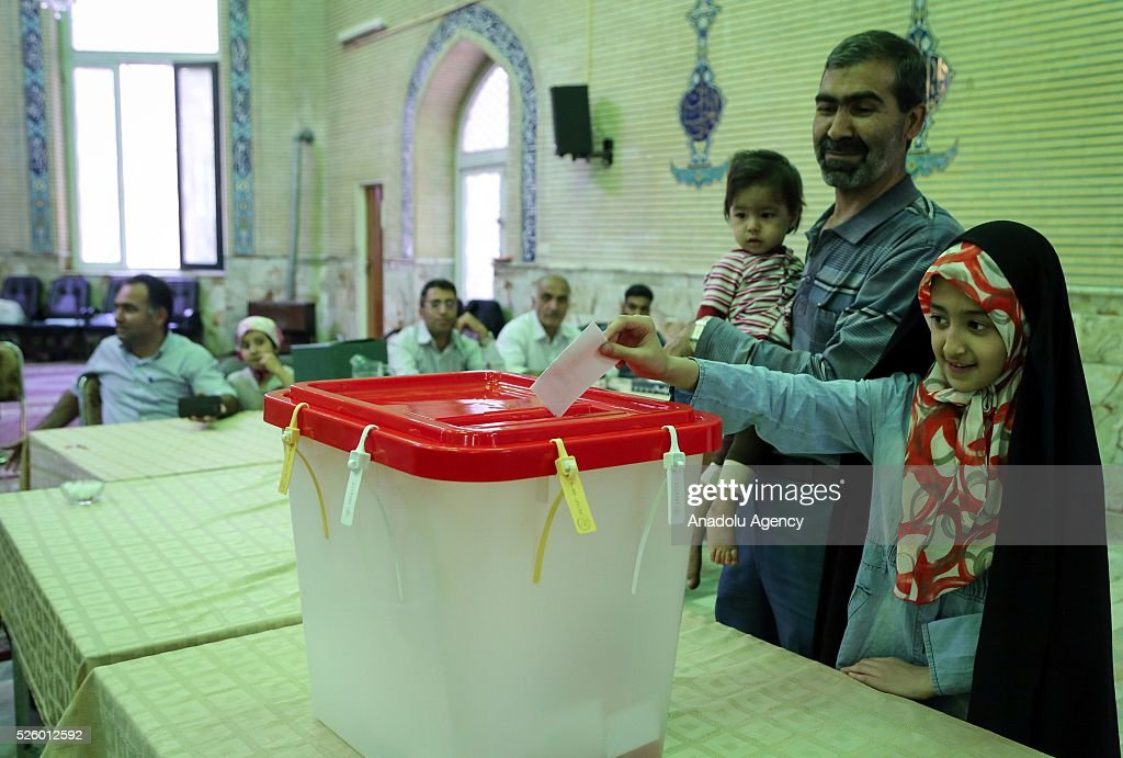 An Iranian girl casts her ballot during a second round of parliamentary elections at a polling station in Shahriar district of Tehran, Iran on April 29, 2016.