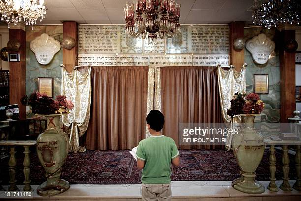 An Iranian Jewish boy reads the holy Torah at a synagogue in downtown Tehran on September 24 2013 Present for more than 2500 years in Persia Iranian...