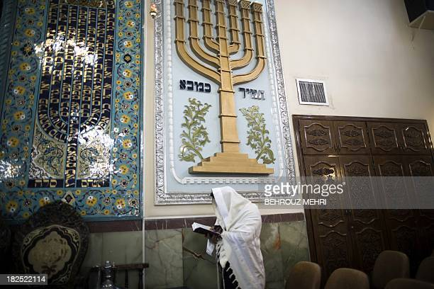 An Iranian Jewish man wearing a Tallit reads the Torah during morning prayer at Youssef Abad synagogue in Tehran on September 30 2013 Present for...