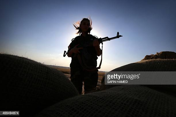 An Iranian Kurdish female member of the Freedom Party of Kurdistan keeps a position in Dibis some 50 kms northwest of Kirkuk on September 15 2014 The...