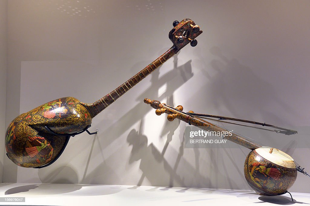 An Iranian lute and an Iranian fiddle (R) displayed during the exhibition entitled 'Les Milles et Une nuits' (The thousand and one nights) at the Arab World Institute (IMA) on November 26, 2012 in Paris. The event runs until April 28, 2013.