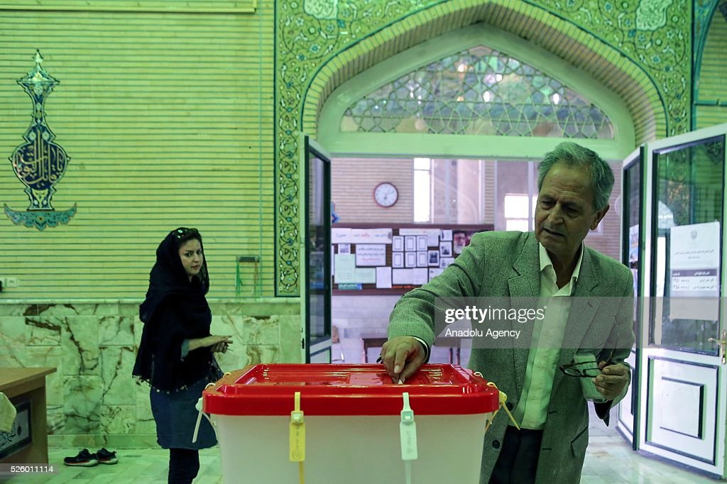 An Iranian man casts his ballot during a second round of parliamentary elections at a polling station in Shahriar district of Tehran, Iran on April 29, 2016.