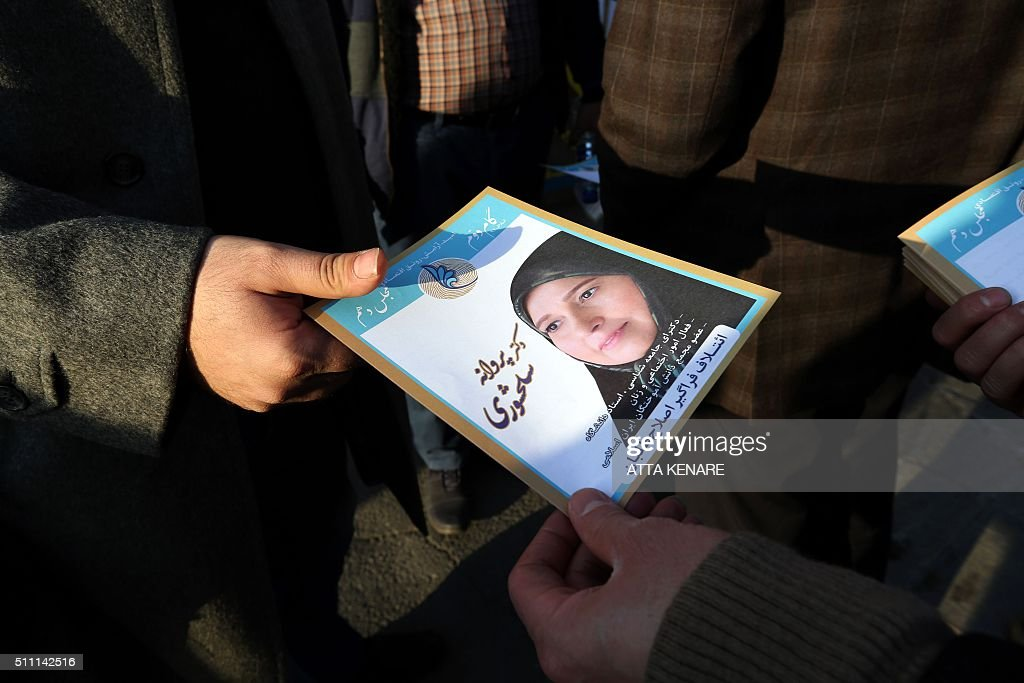 TOPSHOT An Iranian man hands out leaflets for reformist candidate in the upcoming parliamentary elections Parvaneh Salahshori in downtown Tehran on...