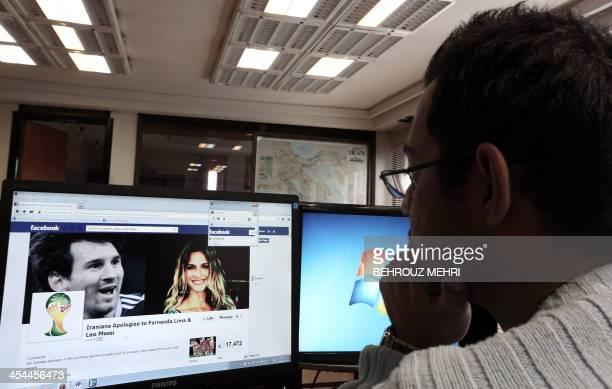 An Iranian man looks at a Facebook page bearing portraits of Argentinian football star Lionel Messi and Brazilian model Fernanda Lima a presenter at...