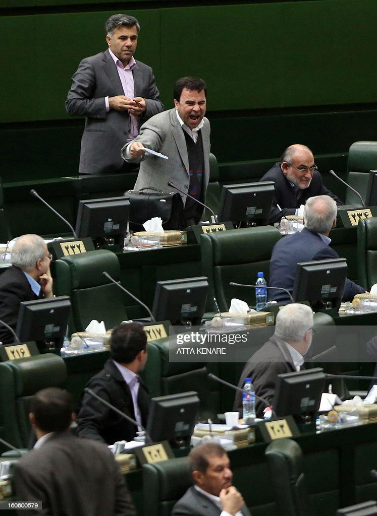An Iranian Member of Parliament (MP) objects as President Mahmoud Ahmadinejad delivers a speech to the parliament in Tehran on February 3, 2013. A large majority of MPs voted in a heated parliament session, broadcast on state radio, to remove the labour and social welfare minister, Abdolreza Sheikholeslam, for refusing to sack a controversial figure, Saeed Mortazavi.