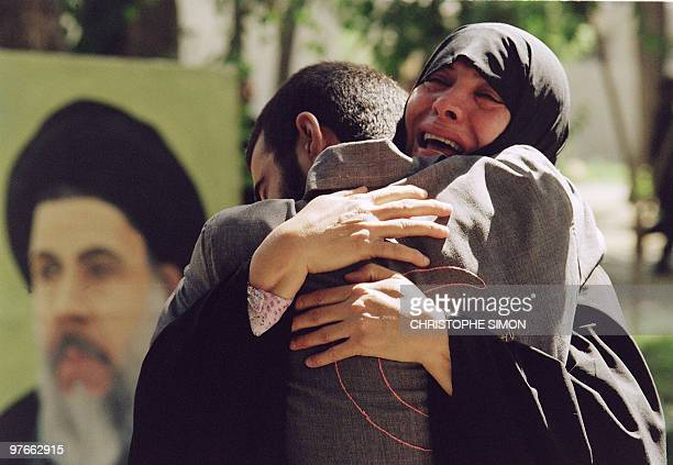 An Iranian mother hugs her son 01 August 1989 in Tehran following his release from an Iraqi prisoners camp Iran was at war with Iraq from 1980 The...