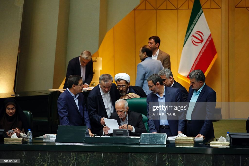 An Iranian MP reads the election results for the new Parliament speaker, during a session for the new parliament in Tehran on May 29, 2016. Moderate conservative Ali Larijani retained the speakership of Iran's parliament despite major gains for reformists in February elections, benefiting from credit gained by his support for last year's nuclear deal. / AFP / ATTA