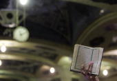 An Iranian Muslim cleric holds a copy of the Holy Koran during a sitin condemning Pope Benedict XVI's recent speech about Islam and holy war in the...