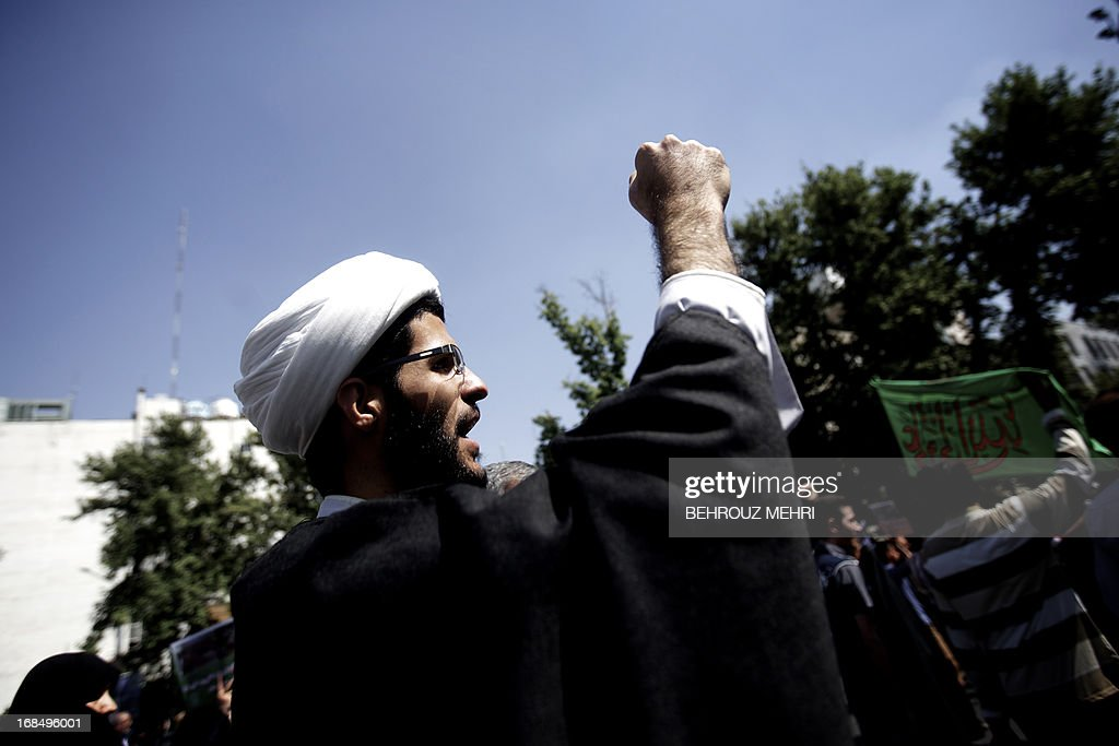 An Iranian Muslim cleric shouts slogans during an anti-Israeli demonstration at Palestine Square in Tehran on May 10, 2013 to condemn last week's Israeli air strikes near the Syrian capital Damascus. Iran has condemned the Israeli strikes and said it is ready to train the Syrian army, which is in its third year of a conflict against rebels seeking to overthrow Bashar al-Assad. AFP PHOTO/BEHROUZ MEHRI