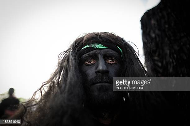 An Iranian Muslim Shiite impersonates the role of Zaafar Jinni the king of Muslim genies the spiritual creatures mentioned in the Koran during the...