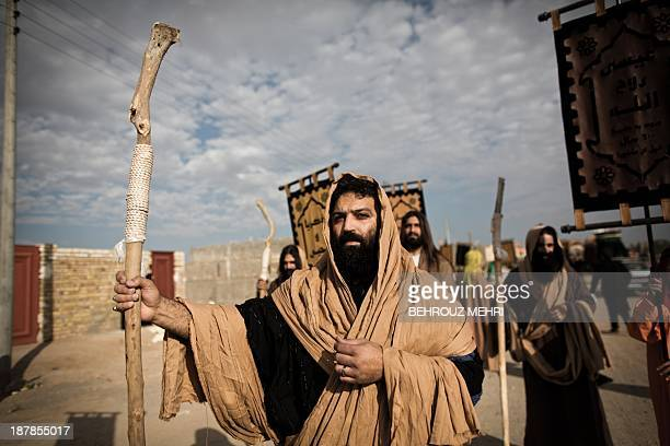 An Iranian Muslim Shiite man impersonating the role of the prophet Moses heading to the battle of Karbala takes part in the annual religious...