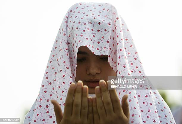 An Iranian Muslim woman performs her Eid alFitr prayers in western Tehran on July 29 2014 Muslims around the world are celebrating Eid alFitr marking...